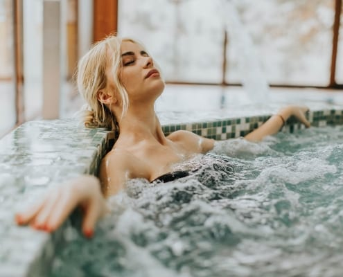 Woman Relaxing In Hot Tub - Hot Water Solutions brisbane